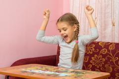 Girl is happy to have found the item you want the puzzle Stock Photos