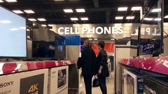 Motion of people looking new tv inside Best buy store with 4k resolution Stock Footage