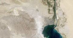 High-altitude overflight aerial of the Suez Canal between Suez and Fayed. Stock Footage