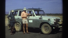 1969: taking a break from safari, accompanied by local people and using the Stock Footage