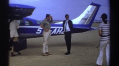 1969: people about to enter the airplane, lions are resting upon the rock SUDAN Stock Footage