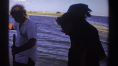 1969: small group of people fishing in the open water on a not so sunny day Stock Footage