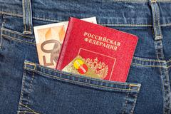 Russian passport, banknote 50 euro and credit card MasterCard in back jeans.. Stock Photos