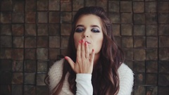 Pretty woman brunette looking to the camera and blowing a kiss Stock Footage