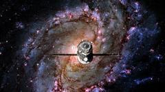 Spacecraft Progress orbiting the spiral galaxy. Stock Photos
