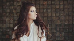 Portrait of pretty wistful brunette woman with bright smokey eyes make-up Stock Footage