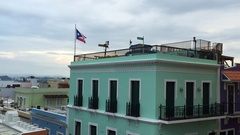 The Puerto Rican flag hangs on top of a building in Old San Juan. Stock Footage