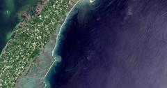 High-altitude overflight aerial of Wallops Flight Center and adjacent coastland. Stock Footage