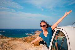 Happy girl on vacation travel by car. Summer holiday and car travel concept Stock Photos