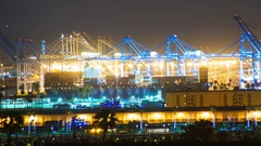 Timelapse of Cranes Loading Container Ship at Port of LA at Night -Pan Right- Stock Footage