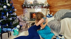 Girls kissing, friendly hugs, friends exchanged greetings with the Christmas Stock Footage