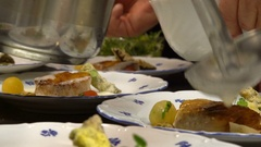 Chef pours sauce fish dish on the restaurant's kitchen. Stock Footage