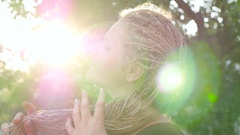 The girl brushing African braids. HD Stock Footage