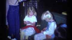 1975: two children holding a red cloth FLORIDA Stock Footage