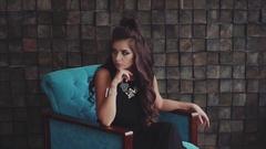 Sensual wistful brunette woman posing sitting in the armchair Stock Footage