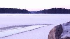 Man walking on weak ice of a freezing lake Stock Footage