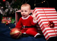 Santa baby boy for christmas in a gift wrapped box Stock Photos