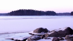 Shore of a freezing lake, open water in the background Stock Footage