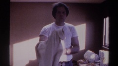 1975: preparing to leave the house to get to work well dressed and character to Stock Footage