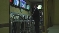 Man in suite bets on sports betting after hard work day Stock Footage