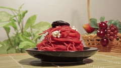 Vegetarian pasta with beetroot sauce, prunes and cheese Stock Footage