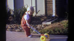 1974: baby playing in pathway of garden FLORIDA Stock Footage