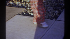 1974: baby stamping feet as it learns to walk FLORIDA Stock Footage