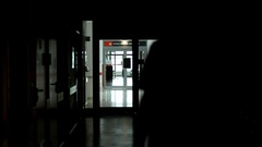 Doctor silhouette walks hospital corridor, hallway, during night duty Stock Footage