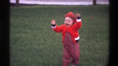 1974: child dancing in the playground along with his father FLORIDA Stock Footage