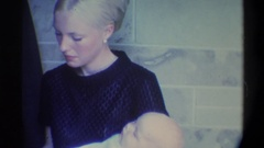 1974: new parents have their child get baptized FLORIDA Stock Footage