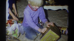 1974: a boy unwrapping a present FLORIDA Stock Footage