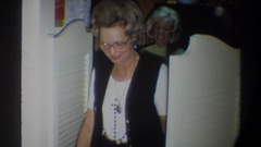 1974: an older woman walking into the room while smiling to the camera FLORIDA Stock Footage