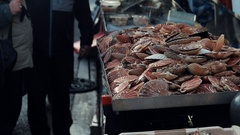Seafood at the street market. Fresh herring and scallops. Real time video. Stock Footage