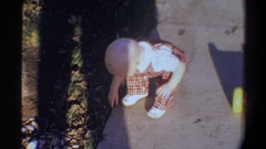 1974: vintage homemovie of a toddler playing outside FLORIDA Stock Footage