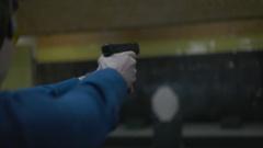 Man shoots a gun at shooting range Stock Footage