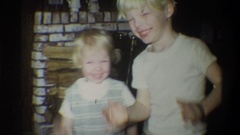 1973: two children smiling next to a fire place keeping warm NEW YORK Stock Footage