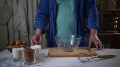 Chef cooking. Man add ingredients for chocolate cake into glass bowl Stock Footage