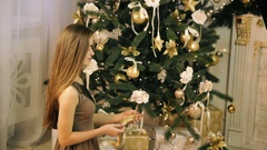 Beautiful woman decorate Christmas tree Stock Footage