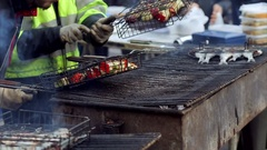 Grilled fish on a grill. Herring fair in north of France, Normandy. Delicious Stock Footage