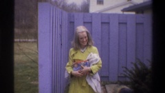 1973: a thirteen second clip of a young mother holding a blanket and a toy, Stock Footage