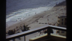1975: looking down at a beach from several floors up at a busy coastline FLORIDA Stock Footage