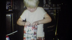 1973: two young siblings eagerly opening their presents. NEW YORK Stock Footage