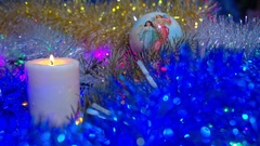 Christmas composition with candle and lights Stock Footage