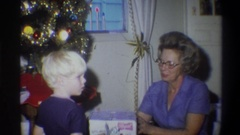 1973: a mom presented a gift to her son on x-mas festival with happiness NEW Stock Footage
