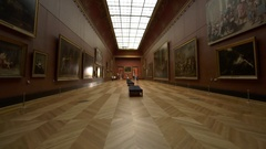 Fast steady shot through art gallery, few visitors Stock Footage