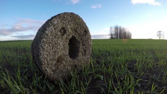 Ancient millstone in crop field, time lapse 4K Stock Footage