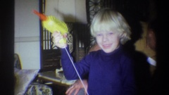 1973: blonde boy plays with pull string toy NEW YORK Stock Footage