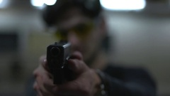 Man holding a gun to the shooting range Stock Footage