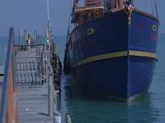 Boat sails away from the pier. Ship leaves Port. Yacht club, port. Stock Footage