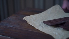 Man hands breaking dark chocolate. Dark chocolate bar. Chocolate pieces Stock Footage